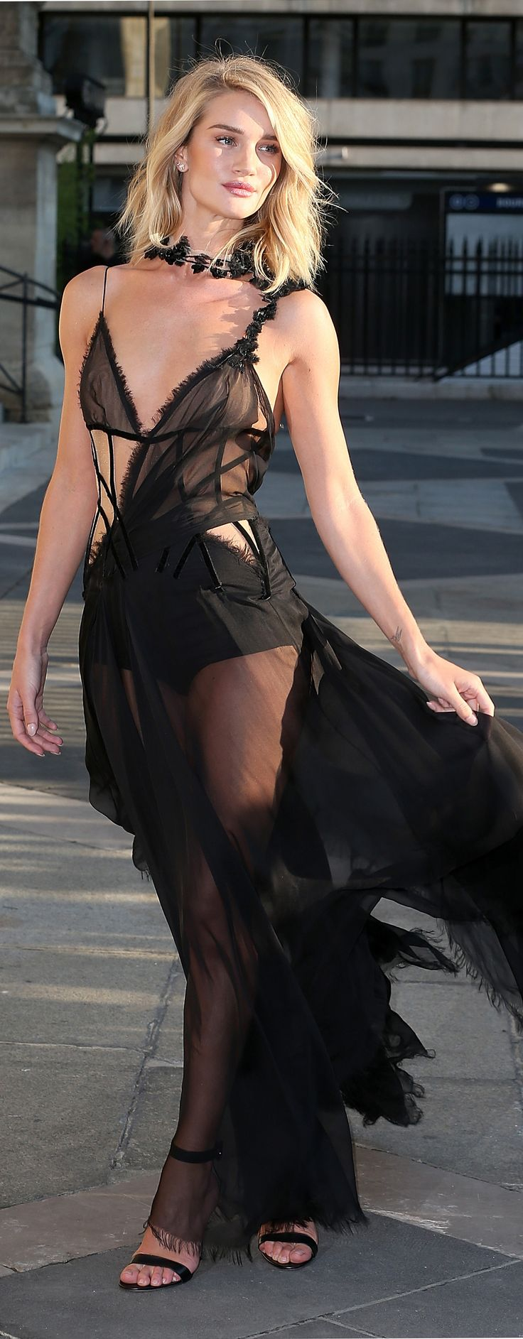 Rosie Huntington-Whiteley made a big entrance to Versace with a stunning black see-through gown.