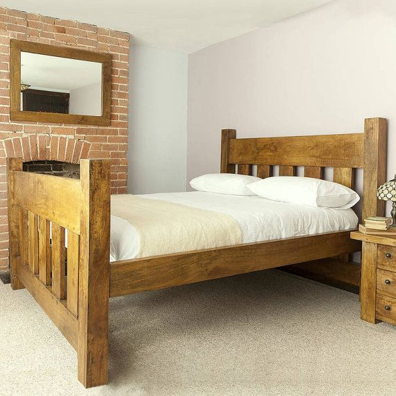 This is a beautifully hand crafted plank bed frame, made with solid redwood pine.  The head board sits 115cm (43.5) high (posts 120cm), while