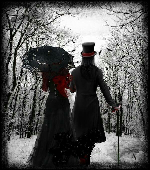 gothic couple walk in winter woods  red accents
