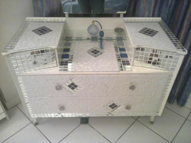My latest creation - one very happy client !  I love my job! Contact me if you need any upgrading those old furniture!  1000in1mosaics@gmail.com