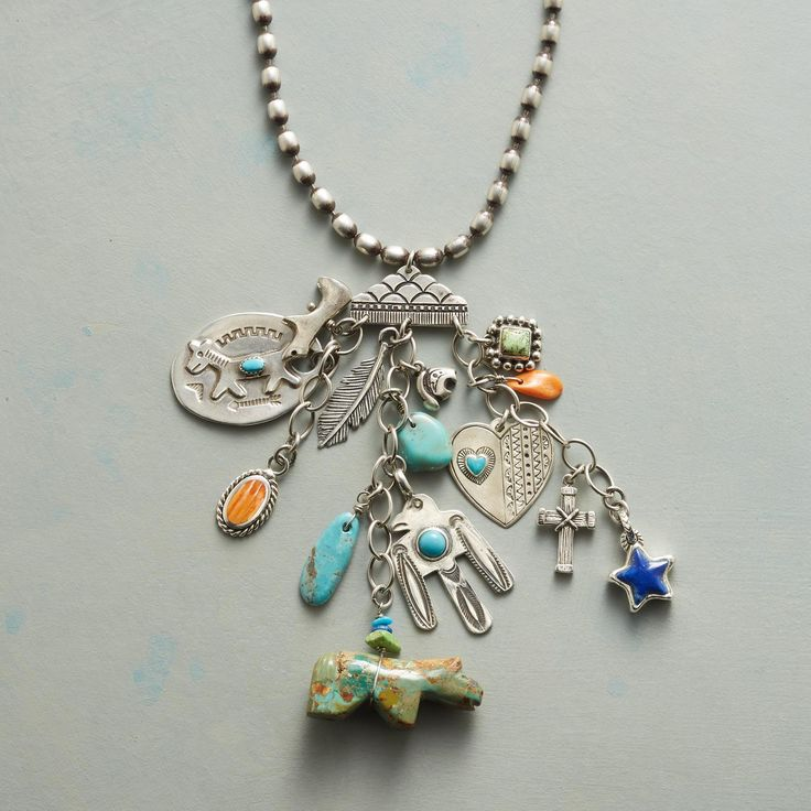"""TRAVELING CHARM NECKLACE -- Talismans to guard your journey—a turquoise spirit bear, a sterling thunderbird, icons and sterling silver charms bearing lapis, orange spiny oyster shell, and gaspeite on a sterling necklace handmade in the USA. Exclusive. 34""""L, 3-3/4"""" drop."""