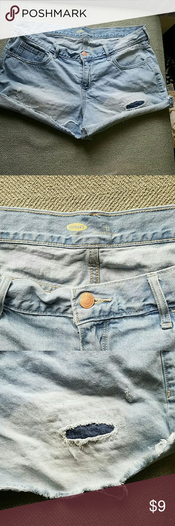 Old Navy Jean Shorts Old Navy Jean Shorts size 12, light wash with stylish fraying and tears, good condition. Please message me if you have any questions! Old Navy Shorts Jean Shorts