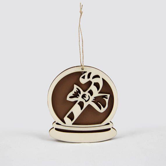Wooden snow globe Christmas ornament with a candy cane.