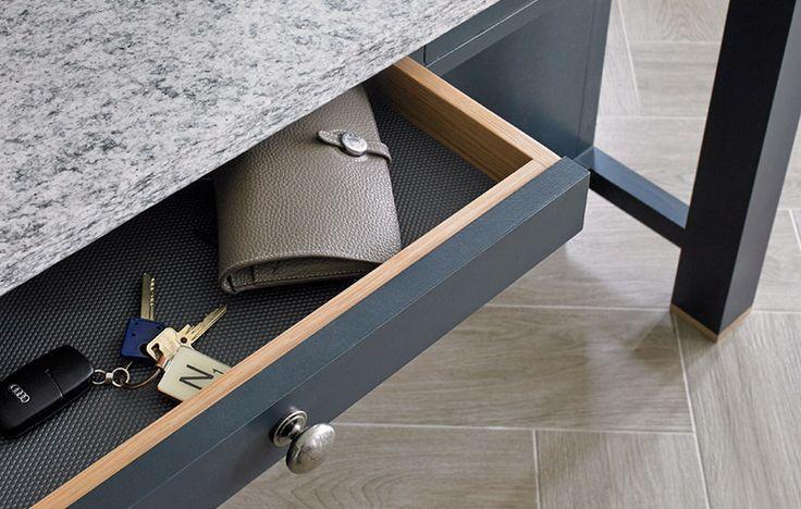 Dark finish fitted kitchen slimline drawer with granite worktop.