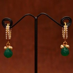 Anvi's beautiful earrings studded with pearls and emerald droplet