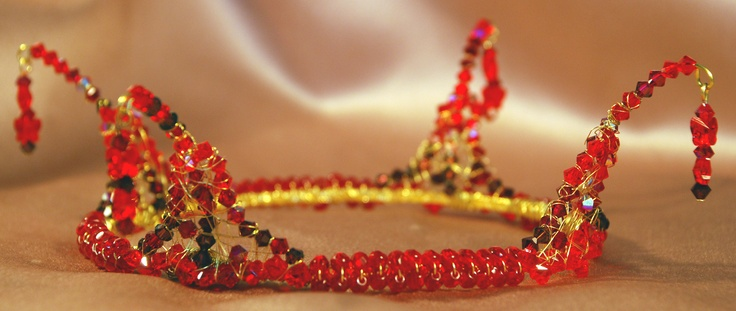 I made this crown for the more adventurous bride.  It has fire polished crystals and Swarovski crystals in tones of red.  The droppers have Swarovski butterfly crystals which were quite difficult to capture on camera.