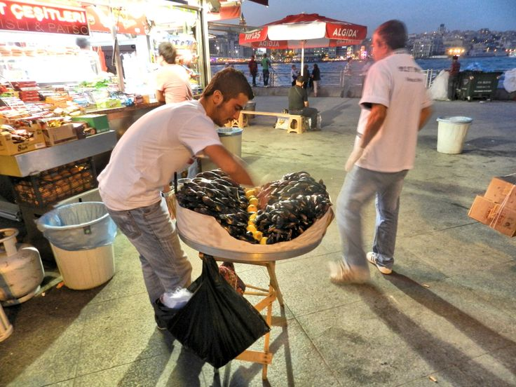 Istanbul vendor of Steaming Hot, Stuffed Mussels.  Unbelievably good! 2012