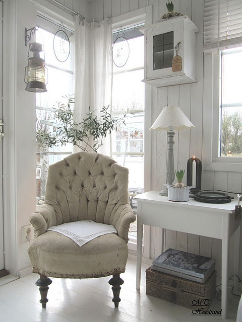 Lovely chair in a corner window spot. Soft and neutral, peaceful.