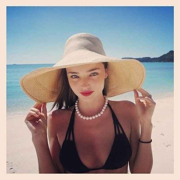 A wide-brimmed straw hat looks amazing at the beach.