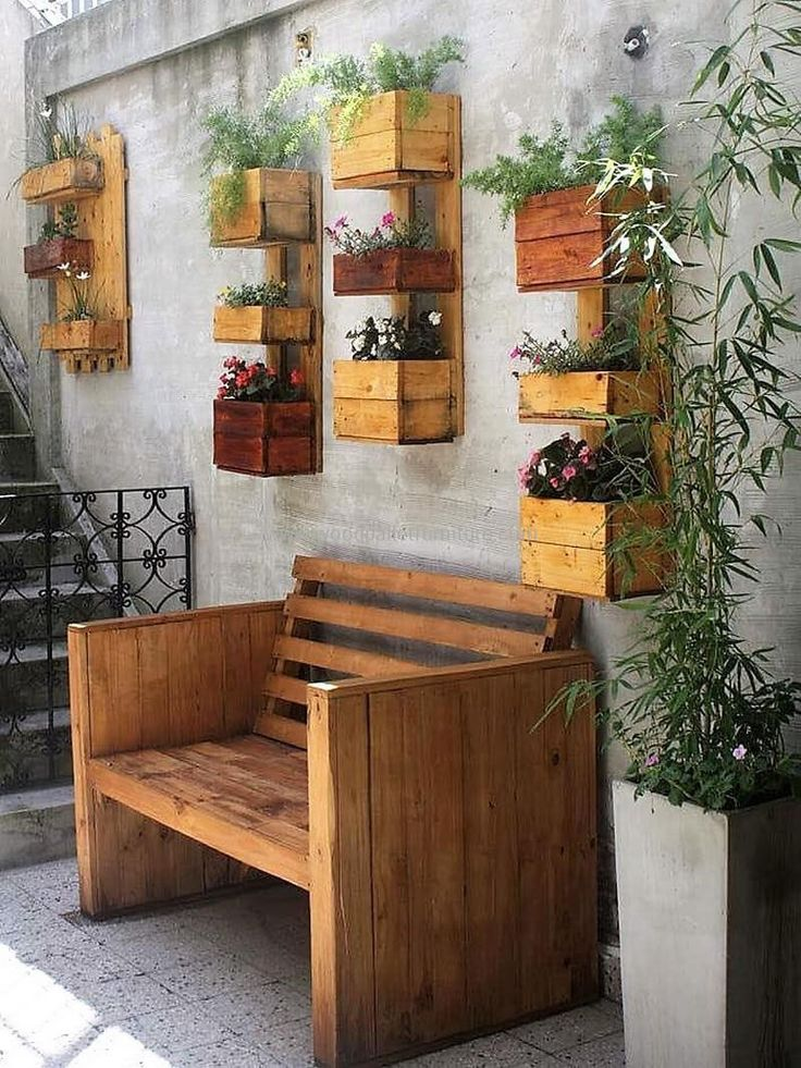 DIY recycled wooden pallet furniture into a