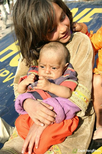 Two children wait for their father to return with food after 2005's Kashmir earthquake. Our organization was in the region at the time handing out emergency relief supplies.