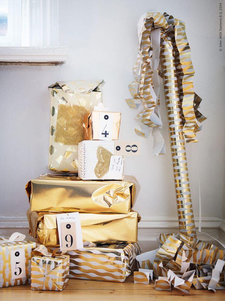 Jul på IKEA 2014: Guldprassliga paket med VINTERMYS presentpapper och HISTORISK hängetiketter.