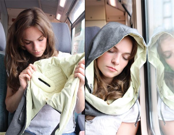 Is it sad that I really want this!? It's a scarf that winds around your head - inside it has a cushion that allows you to rest your head against windows and the fabric cancels noise!