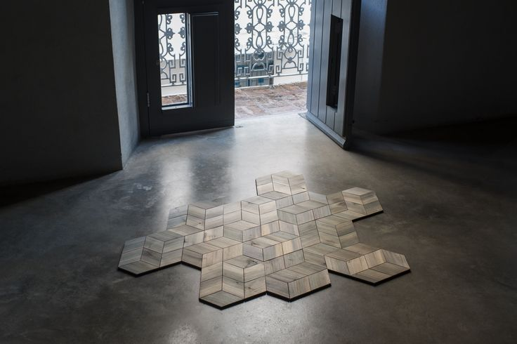 The work of artist and industrial designer Marxz Rosado Ríos combines natural and composite materials and traditional and experimental techniques. The tessellated modules of his La Mantilla floor tiles, made from a durable Caribbean wood and backed with a Velcro-like material, make for an easily customizable surface treatment.