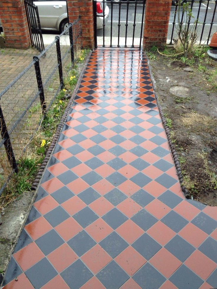 Old concrete path replaced with tiles