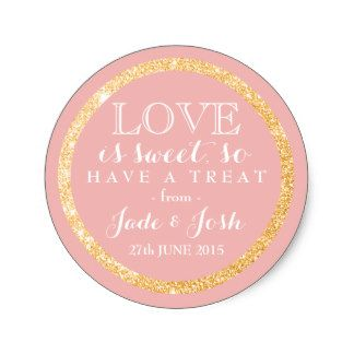 """The perfect finishing touch for a food wedding favor, this faux gold glitter and coral pink round sticker features your names and wedding date along with a sweet message of love. This label is a classy mix of chic and modern with some sparkle and would look great on on jars, boxes, mint tins and even to close a wrapped package. Don't forget to personalize with your name, event date and to change the background color to one of your choice by clicking the """"Customize it"""" button."""
