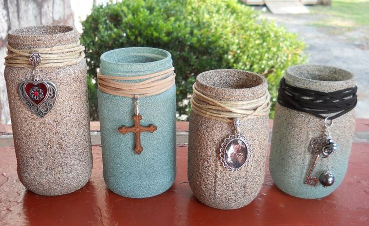Mason jar project (by Jolene Riggs-Burke).  Simply take mason jars and paint with textured spray paint. After they've dried completely (these dried for 6 hours), use either suede cord or hemp and wrap the tops (I used both types of cord). Add a jewelry charm and tie in the back. Apply some super glue to the knots in the back to hold cord permanently.