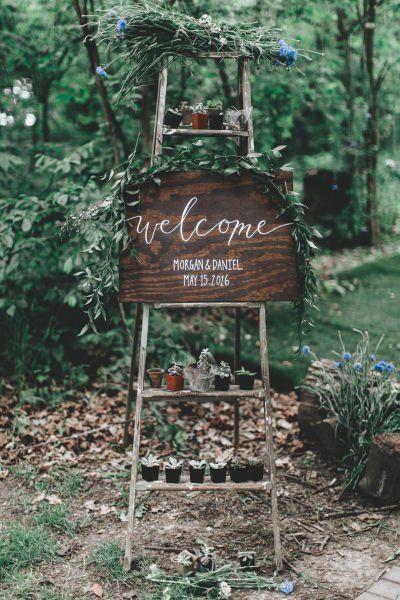 Rustic wedding sign idea - wooden welcome sign on ladder {Surveyor Creative}