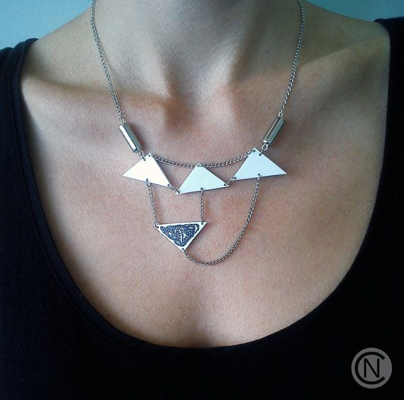 Handmade necklace with four white shrink plastic by NinaCamisi