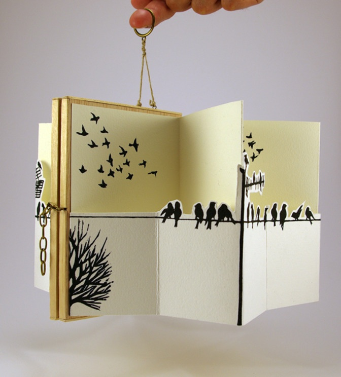 "Artist book ""Among Humans"" by Cassandra Fernández Edition of two artist books inspired on the theme of freedom. Lino-cut prints on paper and wood applications"