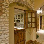 Laundry room door ideas entry mediterranean with stone column wood flooring wood door