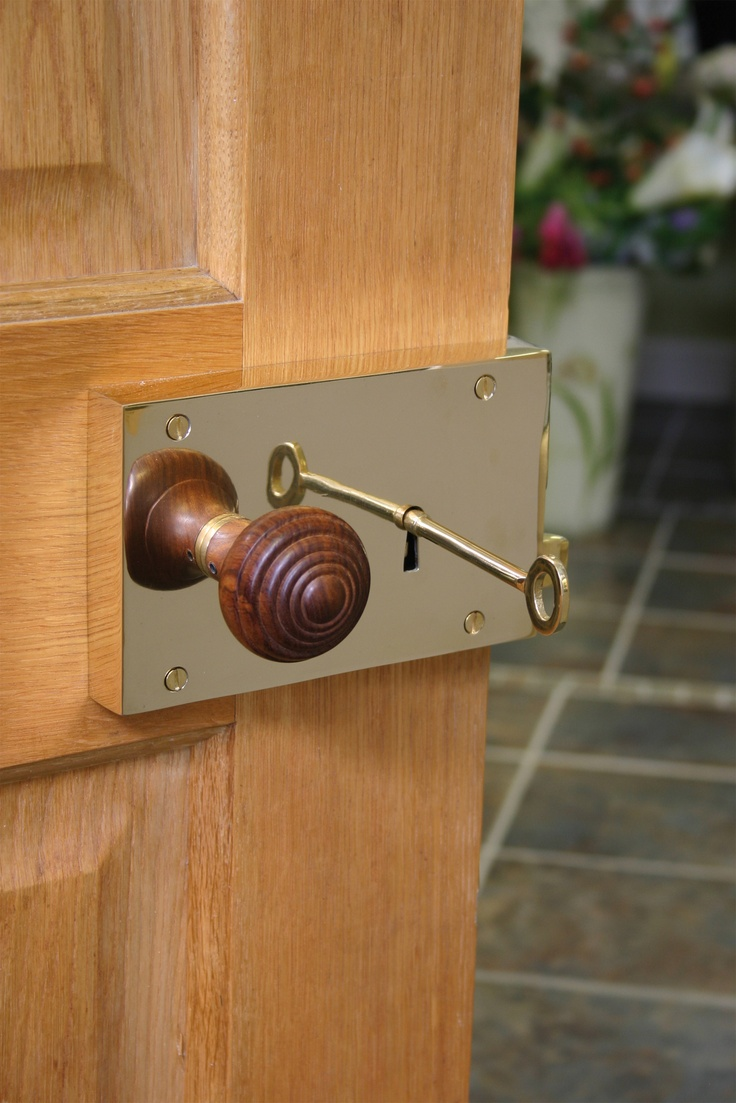A stunning Polished Brass Rim Lock fitted with our Rosewood Ringed Knob Set, ideal for internal doors and adds a touch of class.