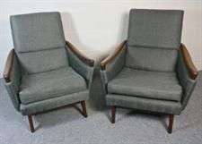 A pair of Greaves and Thomas armchairs  Two chairs from one of the leading UK mid-century manufacturers. Smart, comfortable and stylish; they feature a swept back organic style in the hardwood legs and arms.  One chair is in a slightly darker grey than the other. Size 94cm deep x 70cm wide x 84cm high (seat 40cm high).