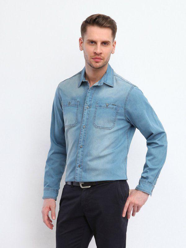 Koszula męska Top Secret z kolekcji wiosna/lato 2014. Koszula jeansowa z kieszonkami. Zapinana na guziki.