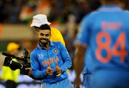 Virat Kohli is visibly delighted, as India secure their second win in the World Cup. (22/2/15)  AFP