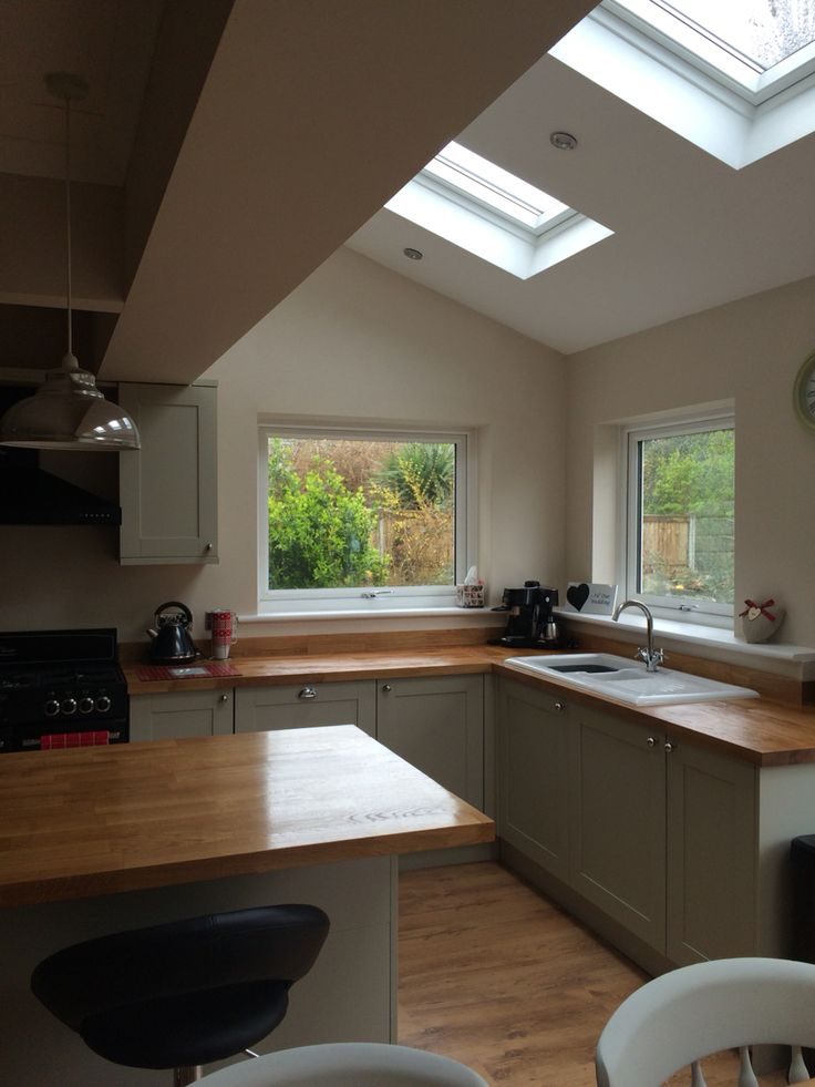 Open plan kitchen; Amersham grey units, solid oak worktops, velux windows