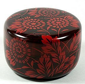 Japanese lacquered tea box or caddy (Usucha-ki or natsume)  for holding the powdered tea used in traditional tea ceremony, red stylized chrysthanthemum and leaves decoration on black, lacquered wood, c. 1980, Japan