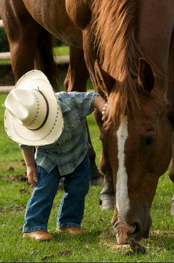 Are you ready to go to work? I'm four,  I can ride out to the pasture now. Well, with my Dad..................or Mom.