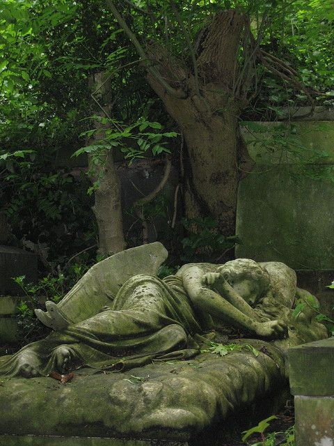 Sleeping angel at Highgate Cemetery in London, England (by Ada and John)