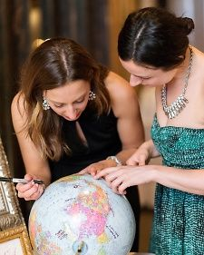 """For the traveling couple, have guests sign an """"adventure globe"""" to suggest future travel destinations."""