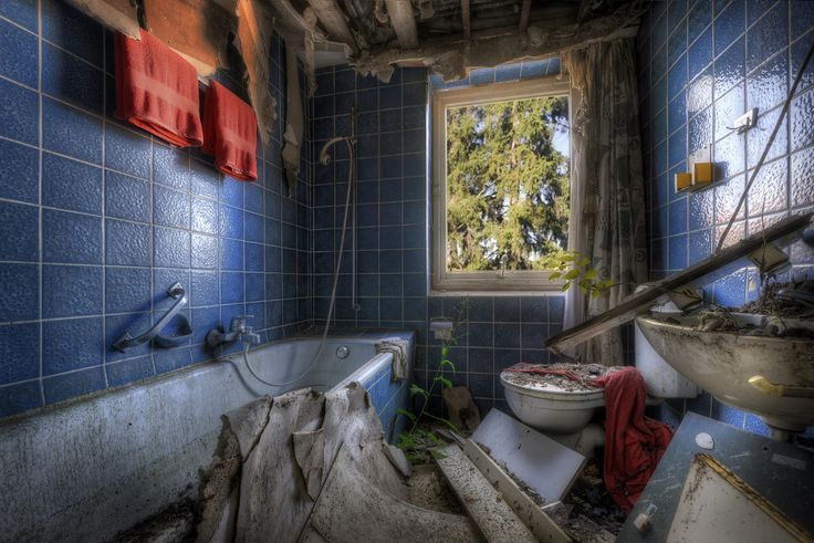 Decayed bathroom inside abandoned hotel.
