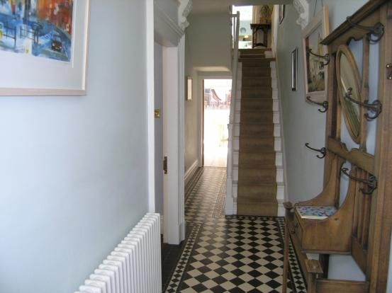 Tiled hallway with pale blue walls