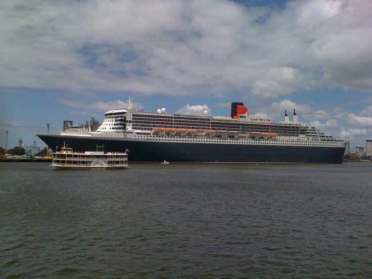 Kookaburra Queen I next to giant cruise ship, Queen Mary 2.