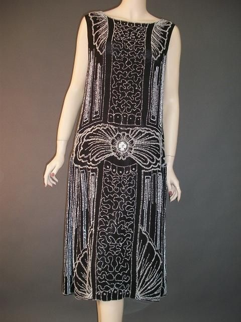 Superb Art Deco heavily beaded flapper dress. (Antique Clothier)                                                                                                                                                      More