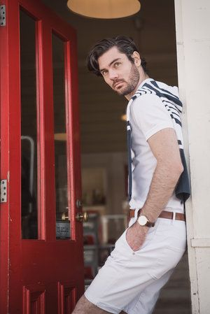 Nathan Smith strikes a pose in the doorway of the Little Blue Cafe located at the very end of the St Kilda Pier in Melbourne... A very summery look on a very cold winter day! #portrait #melbourne #fashion