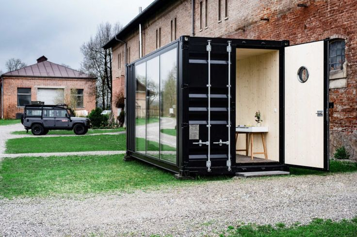 A DECKED OUT SHIPPING CONTAINER MAKES FOR ONE HELL OF A TINY OFFICE