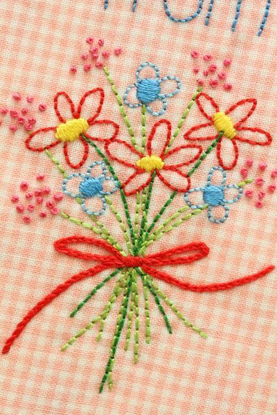 Beautiful embroidered flowers on gingham