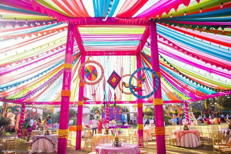 Best Mela Themed Decor for the Mehndi Party. Big Fat Indian Wedding. Colorful Vibrant Fun Mandap. Hanging parrots DIY wedding decor. Fresh flower table centre piece.
