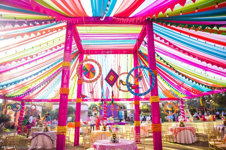 Best Mela Themed Decor for the Mehndi Party. Big Fat Indian Wedding. Colorful Vibrant Fun Mandap. Hanging parrots DIY wedding decor. Fresh flower table centre piece.