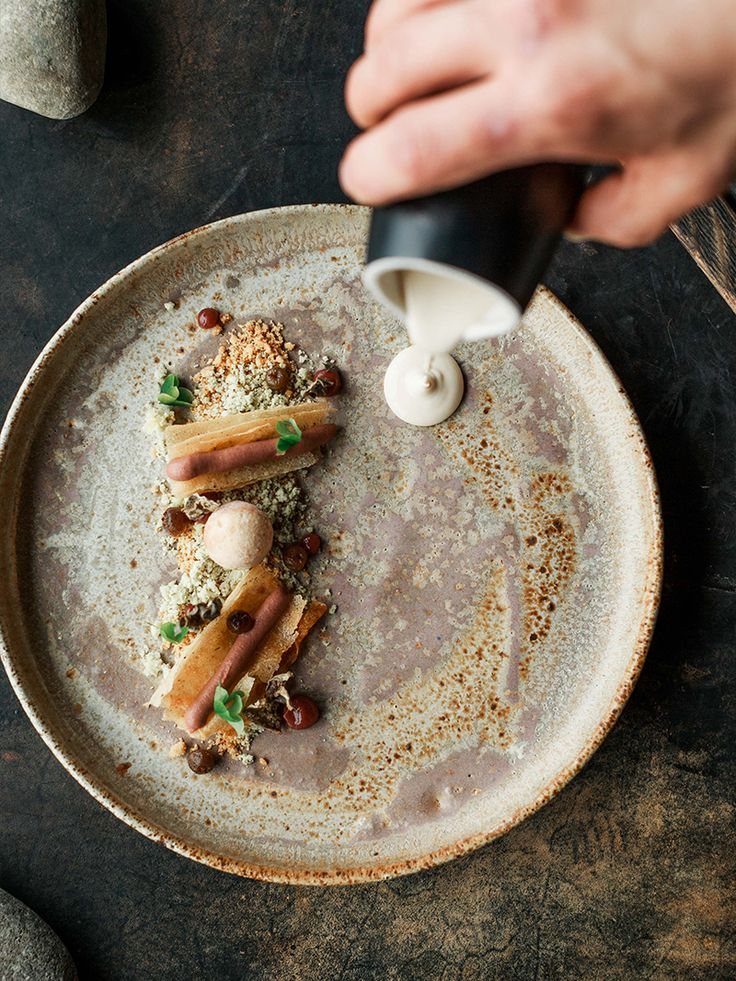 Flavors of the Australian Outback plated in a landscape style. Brown butter…