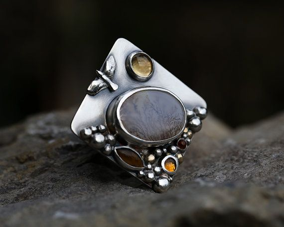 """Connected  Reflection  dendritic agate citrine by spiralstone  """"Reflection """"A Year in the Making"""" comprises twelve sections of the path. On the back of the rings the pathway connects each ring to the next. The path is continuous, beginning before this collection and continuing beyond it."""" Price: $300 USD"""