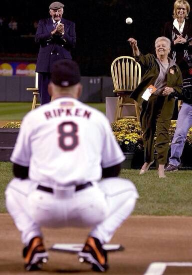 October 6, 2001 ... Vi Ripken throws the Ceremonial First Pitch to her son Cal before the 3001st and last game of his Hall Of Fame Baseball career ... With the late Chuck Thompson and Cal's wife Kelly looking on at Oriole Park At Camden Yards