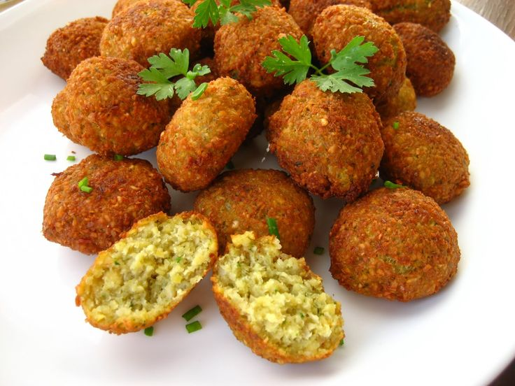 My Falafel Recipe: 1 can garbanzos, 1 onion, 1/2 cup parsley, 2 cloves garlic, 2 tsp cumin, 1/4 cup cilantro, 1 tsp salt, 1 tsp lemon juice, 1 tsp baking powder, 1 tbs olive oil, 1 cup bread crumbs, pepper & cayenne to taste