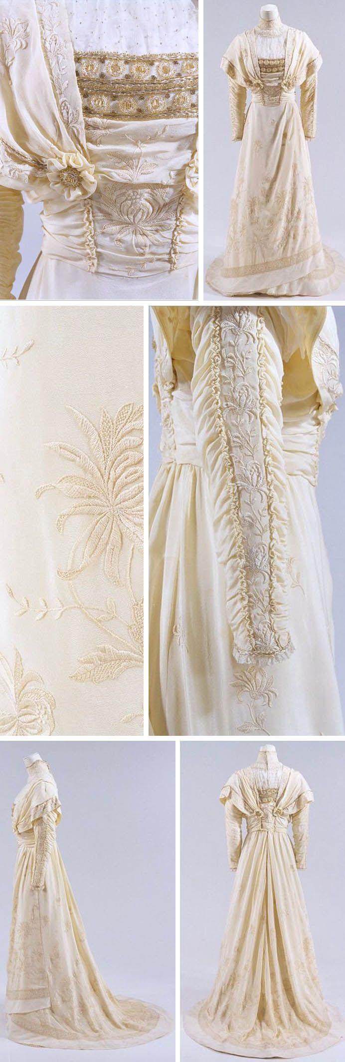 Cream silk dress, ca. 1910-12. Silk, lace, beads. Richly embroidered with chrysanthemums. Slightly higher waist, pintucks, asymmetrical skirt. Bunka Gakuen Costume Museum