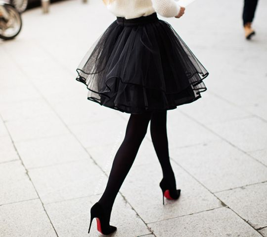 Black tulle skirt with opaque black tights paired with black high heels, also a white blouse