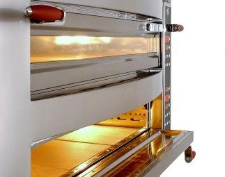Halogen lit pizza decks and panoramic dual pane windows of the Cuppone Michelangelo oven are an asset for any chef.